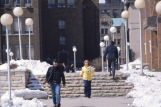 Students walk on the sidewalk between Saint Joan of Arc Chapel and Memorial Library