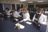 Students look at specimens in a Medical Technology laboratory