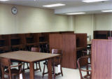 Tables and study carrels line a room on the second floor after the creation of a combined Science...