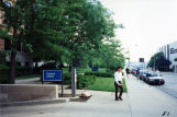 A patron walks on the sidewalk outside the Science Library, circa 1985