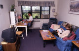 Students study in the living room of an Abbottsford Apartment, 1999