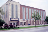 Exterior view of the Varsity Theatre and Holthusen Hall, taken from Wisconsin Avenue, 1990