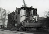 A tractor-trailer is in position at the south side of the William Plankinton Mansion to remove...