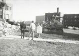 Onlookers stand close by as demolition occurs at the Elizabeth Plankinton Mansion, 1980