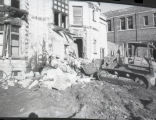 A bulldozer destroys part of the east side of the Elizabeth Plankinton Mansion, 1980