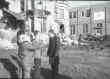 An unidentified gentleman is interviewed by a news crew at the site of the Elizabeth Plankinton...