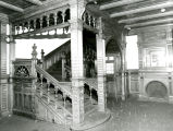 Northeast view of the first floor main hall staircase and fireplace in the Elizabeth Plankinton...