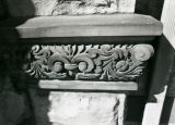 Detail view of a stone carving on the exterior of the Elizabeth Plankinton Mansion, 1978