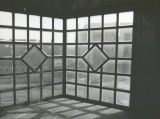 A unique window in the Elizabeth Plankinton Mansion looks out onto the Marquette campus, 1978