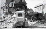 A bulldozer piles up rubble that was once part of the Elizabeth Plankinton Mansion, 1980