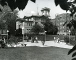 Students walk on the sidewalk to the east of the John Plankinton Mansion during registration,...