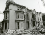 Rubble on the ground surrounds the west side of the John Plankinton Mansion, 1975