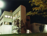 View of the west facade of Emory Clark Hall at night, 1985