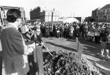 A crowd gathers around the podium for the groundbreaking of Emory Clark Hall, 1981