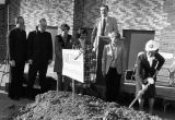 Sister Rosalie Klein lifts a shovel during the groundbreaking ceremony for Emory Clark Hall, 1981