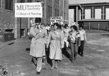Nursing students and staff march to the site of their new building (Emory Clark Hall), 1981