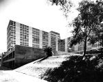 East and north facades of Mashuda Hall, as seen looking up a slight hill from 19th Street, 1964