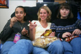 Students eat snacks and watch a movie in Mashuda Hall, 1999