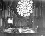 The choir loft, organ and rose window at the north end of Gesu Church, circa 1956