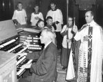 Father Leo Burns, S.J., Provincial, blesses the rebuilt organ in Gesu's Upper Church, 1955