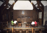 Law students sit at the bench and and tables for the defendant and plaintiff in Howard B....