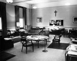 Interior of the recreation room of the Jesuit quarters in Johnston Hall, 1973