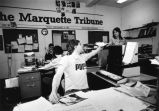 Students work in the offices of the Marquette Tribune on the lower level of Johnston Hall, 1982?