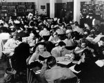 Students crowd the tables in the library on the second floor of Johnston Hall, 1947