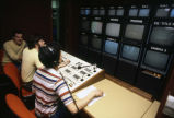Students work the equipment in the Marquette University Television's production-control room,...