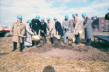 Dignitaries lift shovels of dirt at the Alumni Memorial Union groundbreaking ceremony, 1989