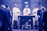 Albert J. DiUlio, S.J. and Bishop Leo J. Brust lead a Mass, 1990