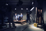 On-screen talent and camera operators work on the Marquette University Television studio floor