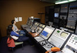 Students sit at the master control and head end for the student television station in Johnston Hall