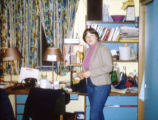 A student poses next to the desk in her room in O'Donnell Hall, 1981