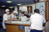 Students gather at the O'Donnell Hall reception desk, 1994-1995