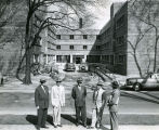 A group of men gather at the O'Donnell Hall construction site, circa 1952
