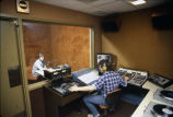 Students sit in the control room and recording studio in Johnston Hall (Instructional Media...
