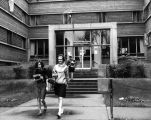 Barbara Watson and Katy Straub exit O'Donnell Hall, 1965-1966