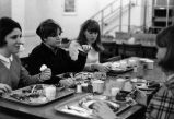 O'Donnell Hall residents eat a meal at one of the tables in the cafeteria, 1968