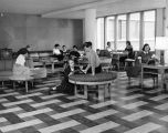 Students gather and socialize in the O'Donnell Hall lounge, 1952