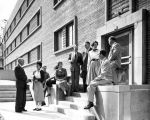 A group gathers on the steps leading to a side entrance to O'Donnell Hall, circa 1955