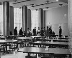 A tour group visits the McCormick Hall cafeteria, 1968