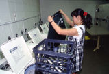 A McCormick Hall resident washes her clothes in the laundry room, 1996
