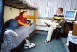 Two young men chat in their room in McCormick Hall, 2000