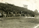 Fans fill the seats of the new Marquette University Stadium and earnestly watch the action on the...
