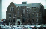 North facade of Sensenbrenner Hall, as viewed from a parking lot across Wisconsin Avenue