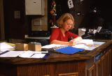 A student works at the front desk in Cobeen Hall, 2000