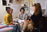 Three girls socialize in a dorm room in Cobeen Hall, 1984