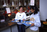 Students talk while holding their trays in the Cobeen Hall cafeteria, 1998