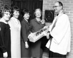 The widow and three daughters of Charles T. Cobeen stand with Marquette University President, Rev....